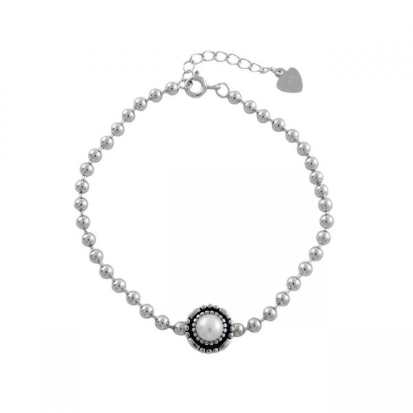 Armband van zilveren kralen met parel